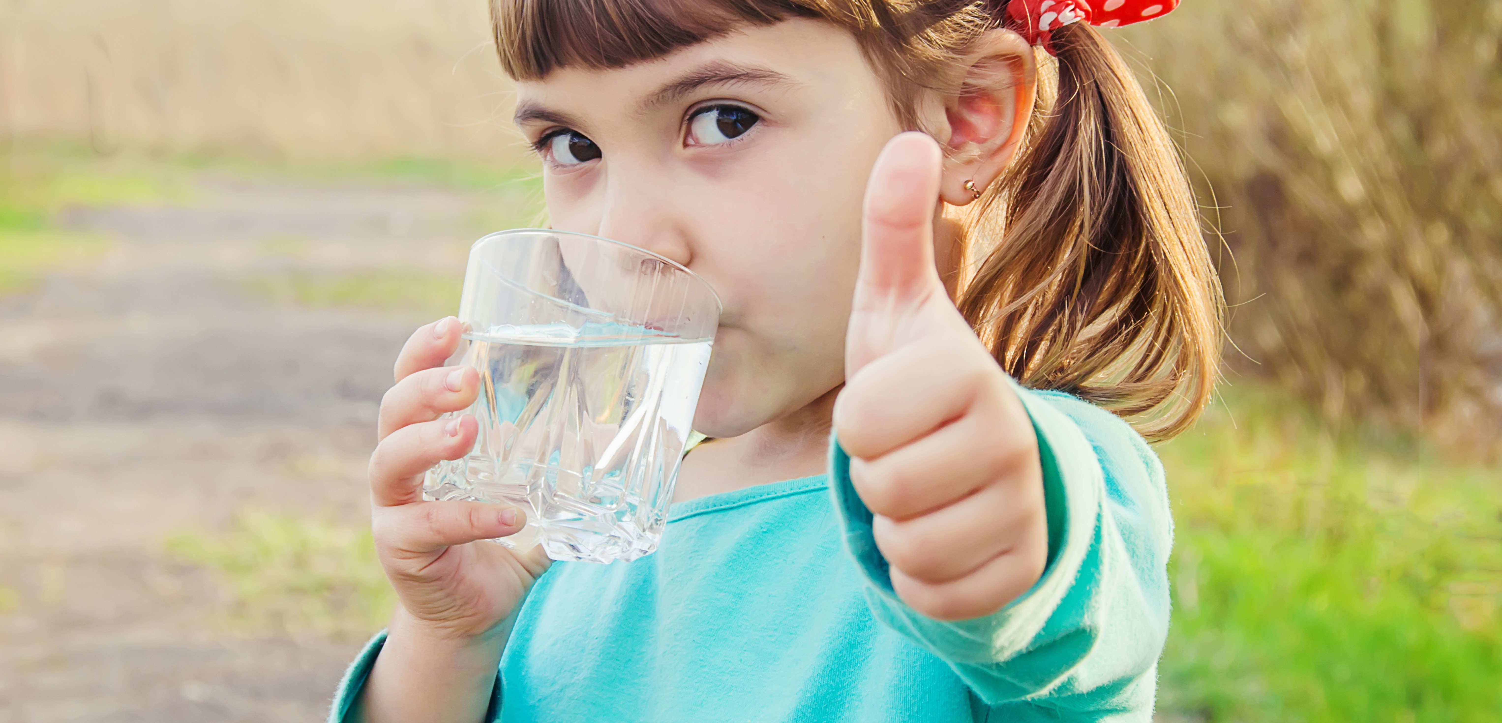image: child with glass of water
